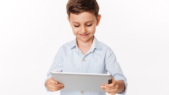 portrait-of-satisfied-cute-little-kid-playing-games2